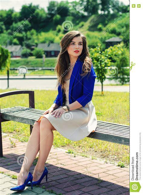 girl sitting on bench beautiful girl sitting on bench stock photo image of long dress 74944840