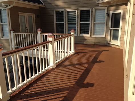 two tone deck copper solar lights solid stain painted deck rails chocolate stain southern