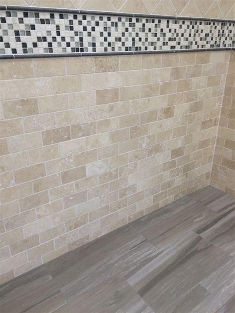 Dark porcelain title bathroom floor with half wall tile design