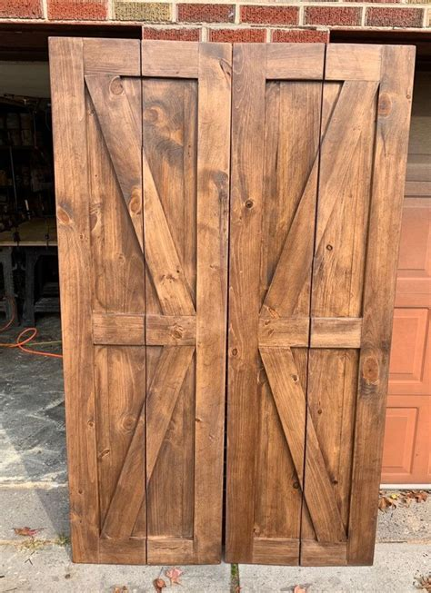 bi fold barn door   bifold barn doors exterior