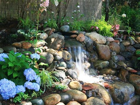 rock waterfalls for gardens backyard river rock waterfall with blue hydrangea hgtv