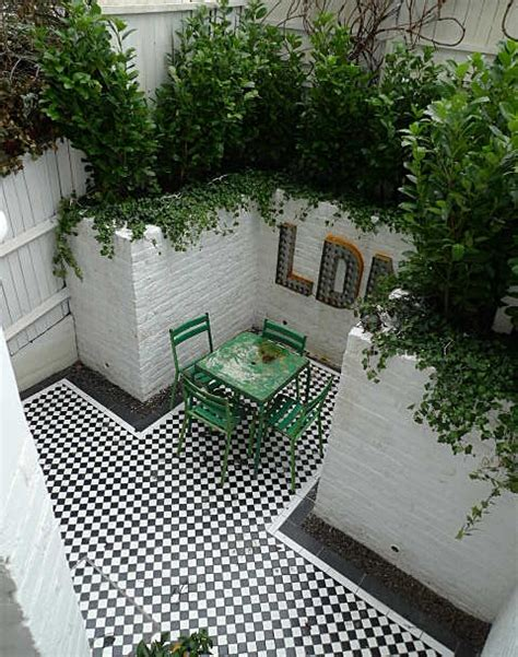 White Garden Walls Black And White Mosaic Tile Courtyard Garden