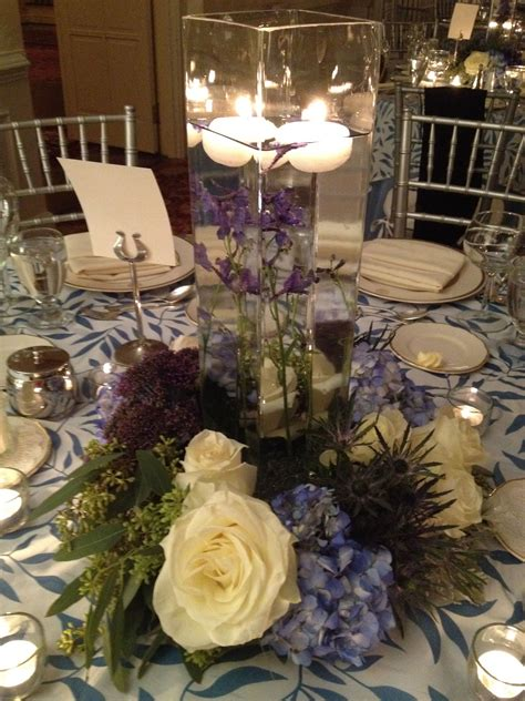 25th wedding anniversary centerpieces plus this artfully lit spray arrangement provided a