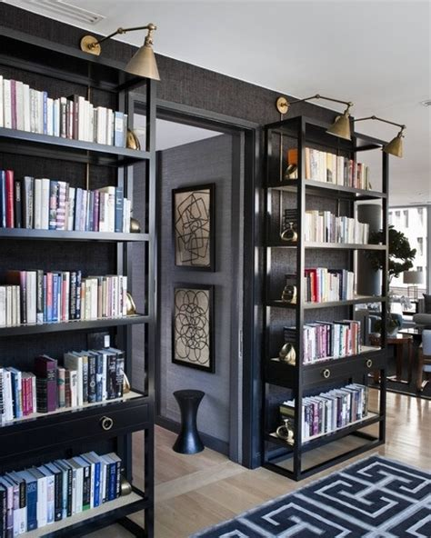 dark grey walls with lights above bookcases jay s office