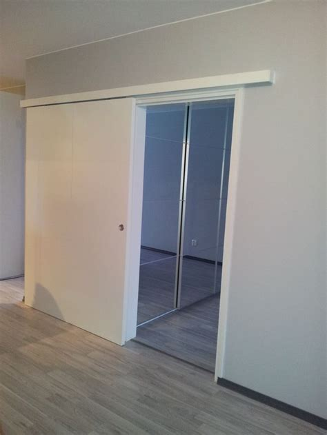 Ikea Barn Doors A Sliding Door Replaced A Regular Door More Space Ikea Cabinets With Mirrors Inside The