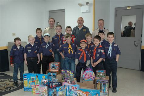troy cub scout troop collects for toys for tots lincoln