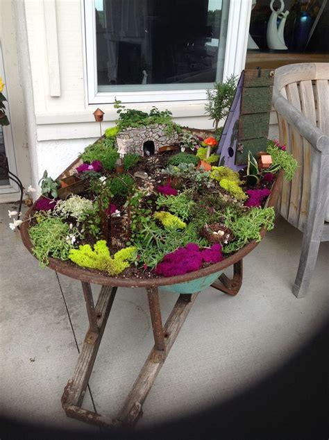Wheelbarrow Garden Ideas 25 Best Ideas About Wheelbarrow Garden On Wheelbarrow Planter Wheelbarrow And