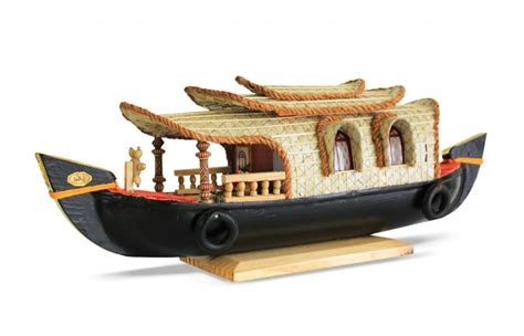 wooden boat house best souvenirs to buy when in kerala