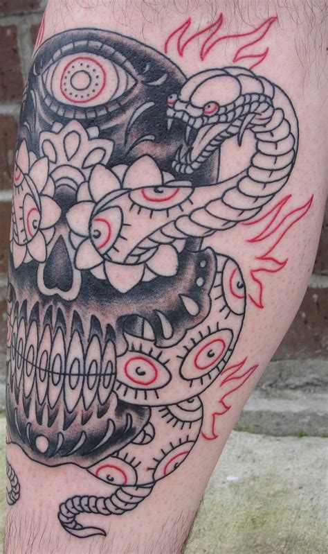 snake and skull tattoo snake tattoos designs ideas and meaning tattoos for you