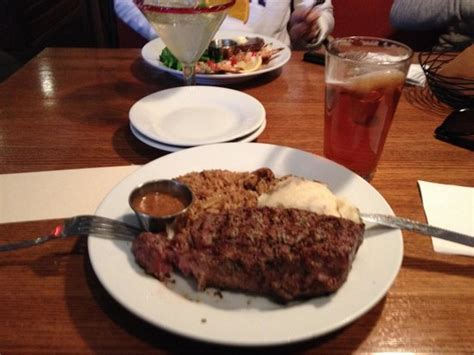 lone star steak house delmonico with baked potato and steamed broccoli foto di lone star steakhouse