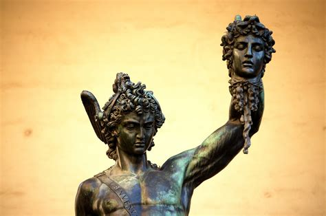 cellini bronze statue of perseus holding the severed head