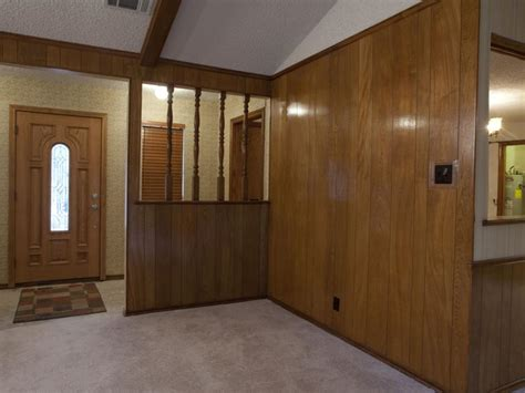 70s wood paneling laminate paneling was a popular room transformations from the property brothers property