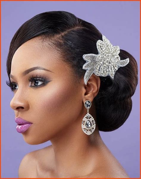 wedding hairstyles buns to the side natural wavy side bun wedding hairstyle for black women