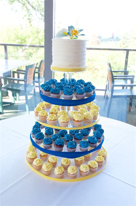 Madeleine Cupcakes Blue blue and yellow cupcake tower for a wedding with swirl
