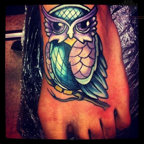 purple tattoo ink purple and blue ink owl on foot