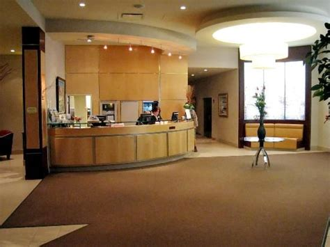 Hotel Lobby Reception Desk Dropped Ceiling Curved Reception Desk Reception Area Design Receptions