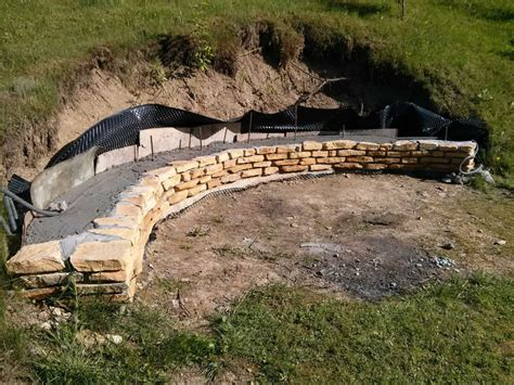 build pit on hill they built a fireplace into their sloping hillside the results were and are stunning