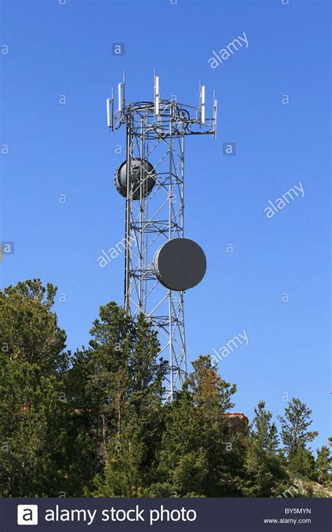 microwave and cell phone antenna tower on the top of a hill stock photo royalty free image