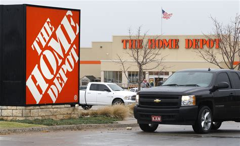 home depot reports that quarter earnings climb 12 5