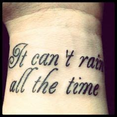 it can t rain all the time tattoo inner arm the stippled style