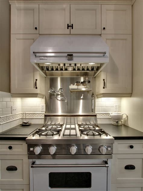 Small White Kitchen With Steel Hood | white viking range and hood transitional kitchen