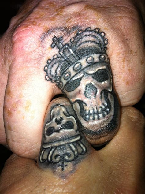 skull tattoo on finger 6 king crown tattoos on finger