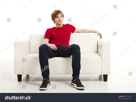 sitting on a sofa handsome young man home sitting on stock photo 98171009