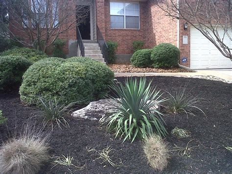 river rock flower bed pictures for miguel s lawn tree service in san antonio