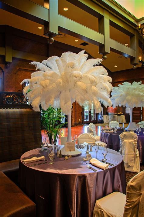 17 Best ideas about Feather Wedding Centerpieces on