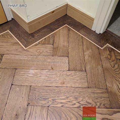Parquet Herringbone wood flooring with border
