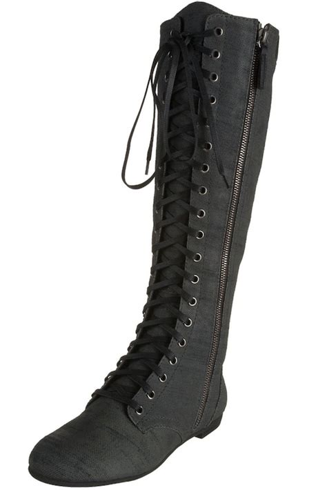 nicki minaj in giuseppe zanotti lace up flat boots