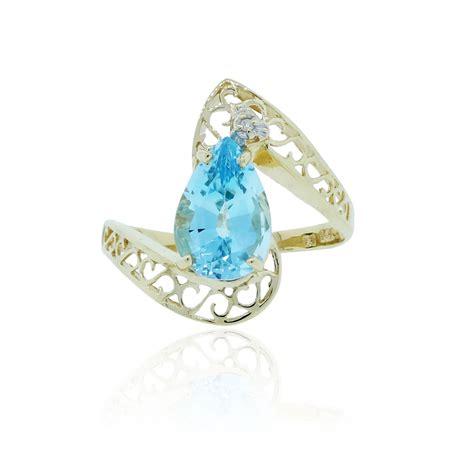 14k yellow gold blue topaz 01ctw ring