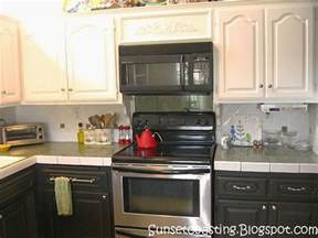 Black And White Kitchen Cabinets Pictures by Sunset Coast My Black And White Painted Kitchen Cabinets