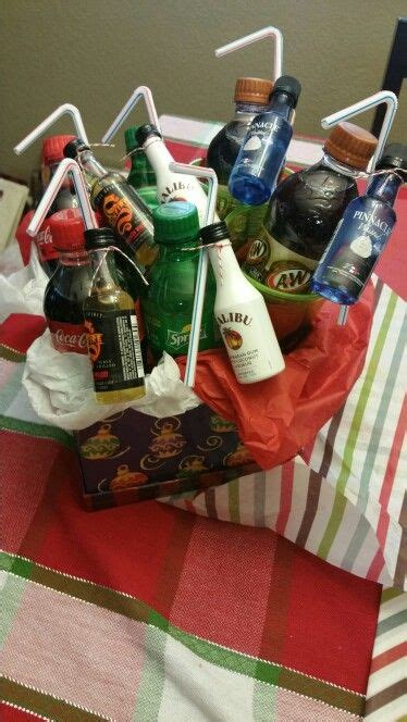christmas booze gifts mini bottles and mini soda bottles in a gift basket as a gift to couples diy