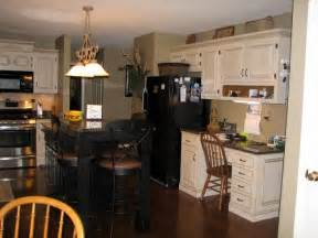 black kitchen cabinets with black appliances mixing stainless and black appliances for the home