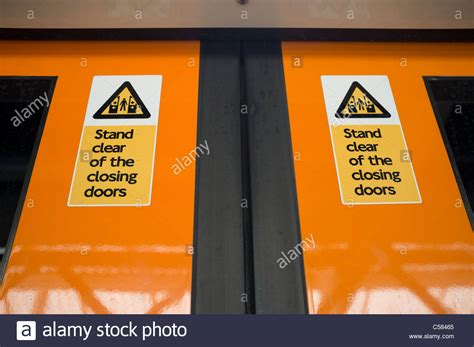 Stand Clear Of The Closing Doors by Stand Clear Of The Closing Doors Signs On