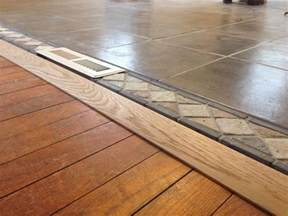 threshold tile to wood floor in open concept living room and kitchen pieces of living dining