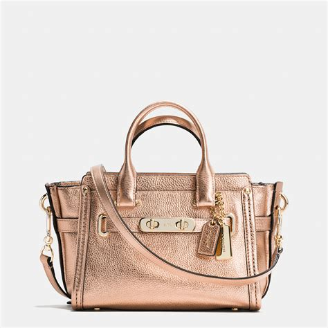 lyst coach swagger 20 in metallic pebble leather in pink