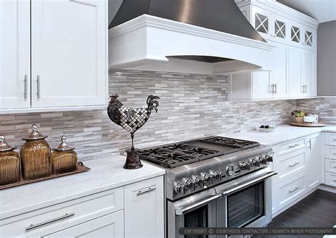 white modern kitchen with marble subway tile backsplash