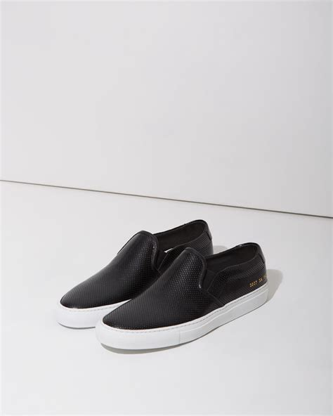 perforated slip on sneaker lyst common projects perforated slip on sneakers in black