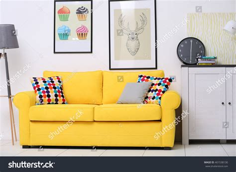 sofa in the living room yellow sofa in the living room stock photo 401538130