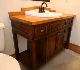 crafted custom wood bath vanity with reclaimed sink