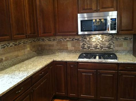 travertine and glass mosaic backsplash tile details by