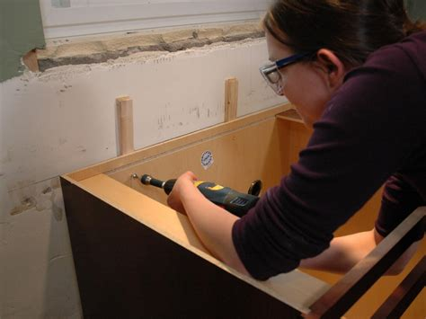 mounting pedestal sink to drywall kitchen catch up how to install cabinets how tos diy