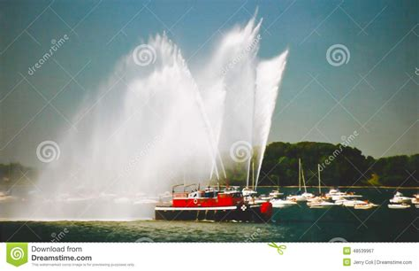 tug boat water cannon tug boat sprays water canon editorial photography image