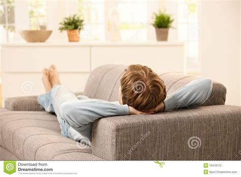 Lying On A Sofa by Lying On Sofa Stock Photography Image 16418772