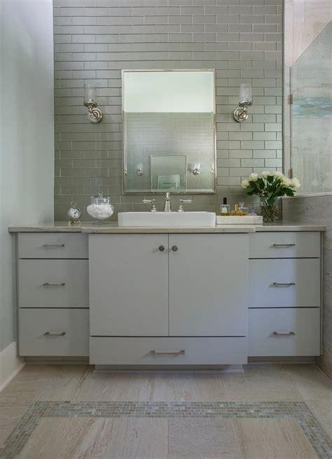light grey glass backsplash light blue washstand with gray glass backsplash tiles