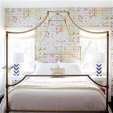 gold canopy bed room with capiz flower chandelier contemporary