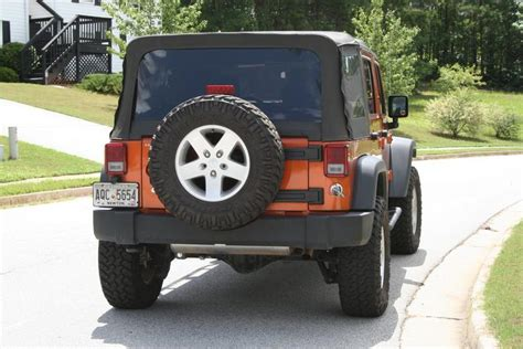jeep wrangler with wheel spacers show me your wheel spacers before and after jk forum