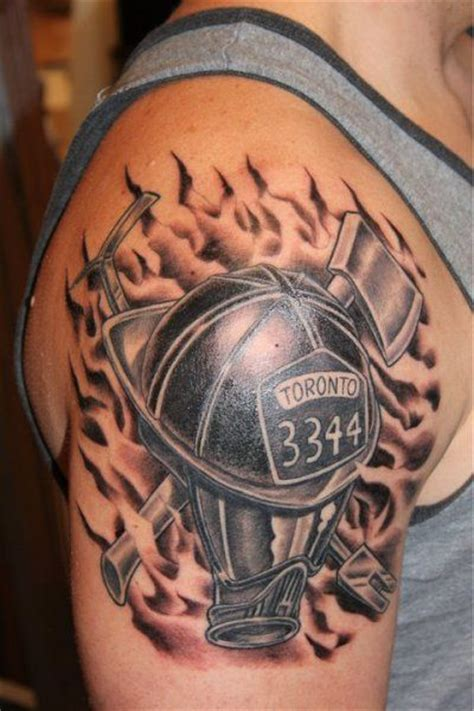 criss cross tattoo firefighter helmet and mask criss crossed with
